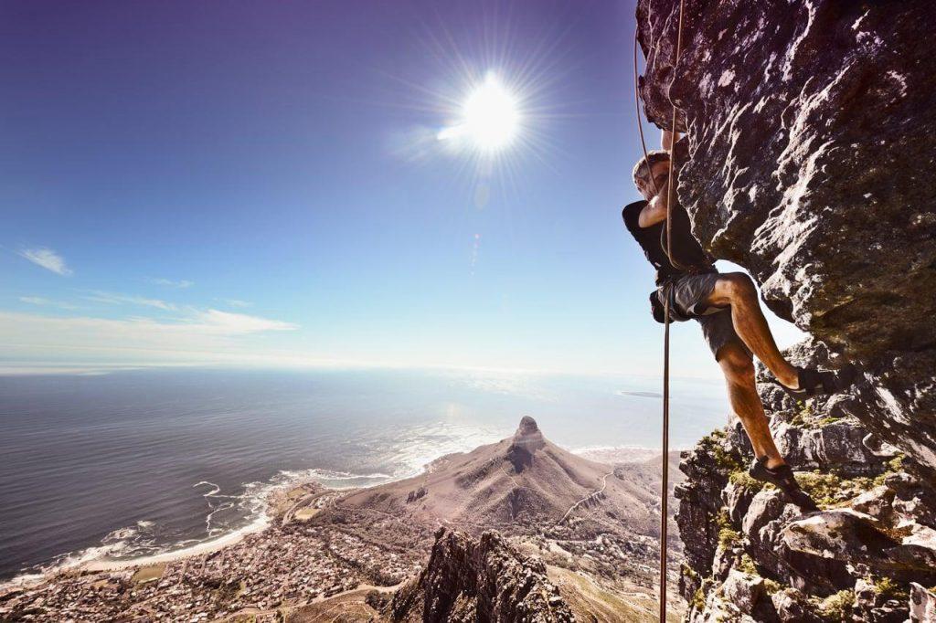 man rock climbing table mountain