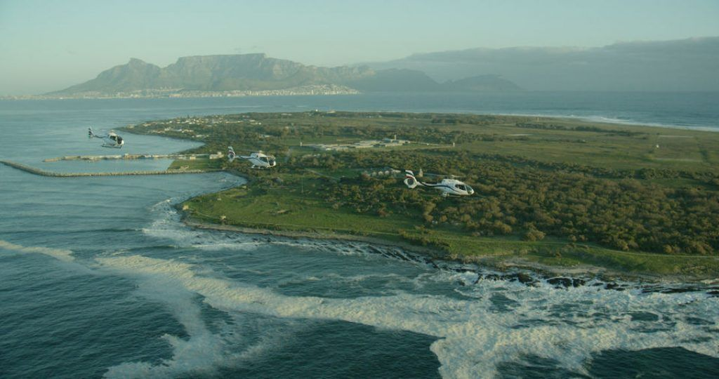 helicopter flying over Robben Island