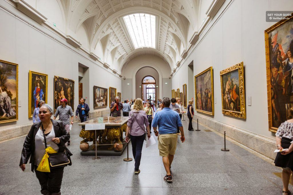 busy hallway in the prado museum, madrid