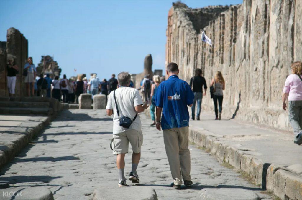 walking through pompeii ruins