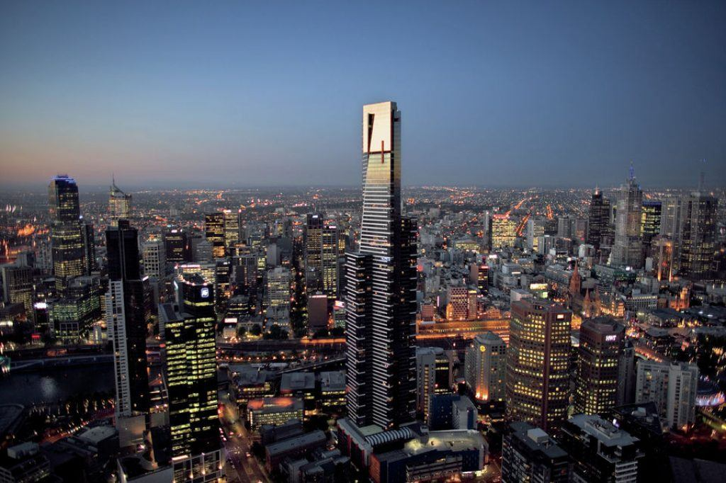 Eureka Tower in Melbourne in the evening surrounded by city lights