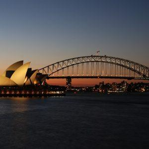 Sydney Opera House and harbour bridge at sunset