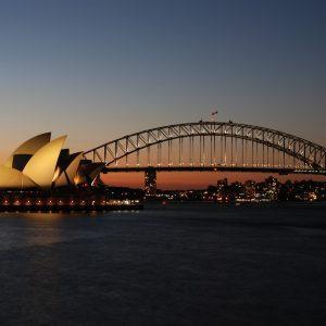 Sydney Opera House and harbour bridge at sunset