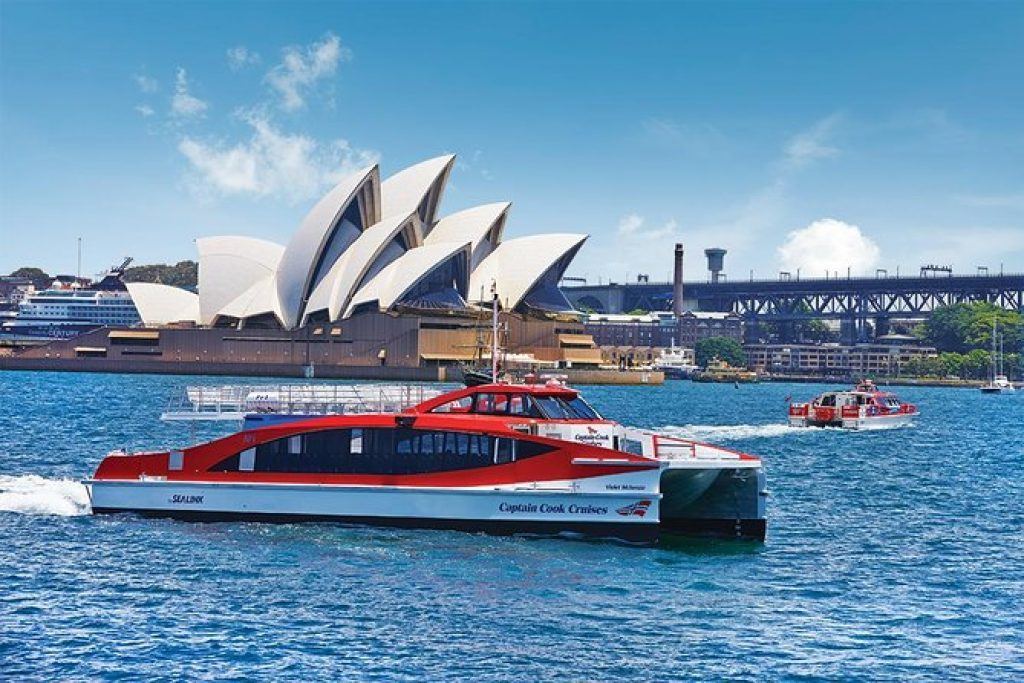 red cruise boat in Sydney Harbour