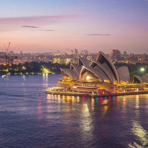 Sydney Opera House lit up in the evening