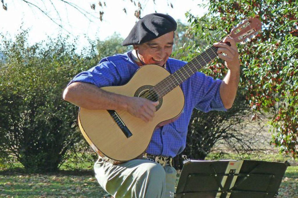 argentine man playing guitar