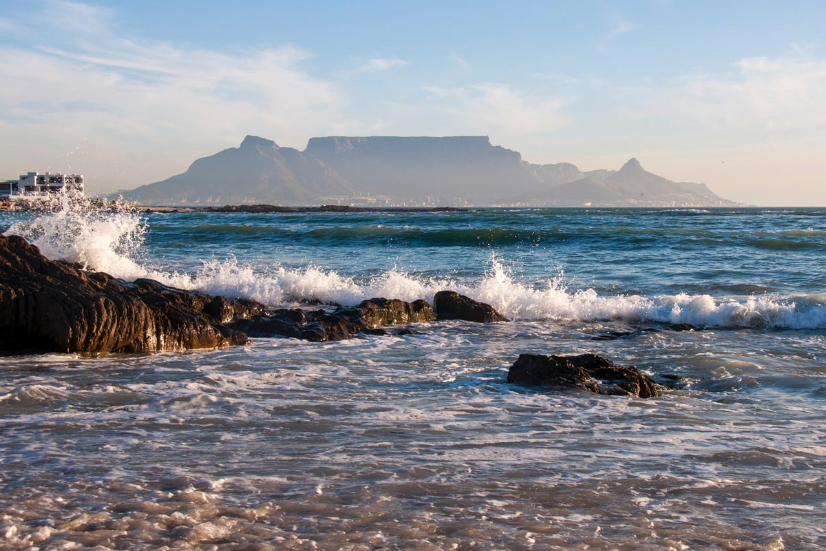 view of table mountain and cape town from bloubergstrand