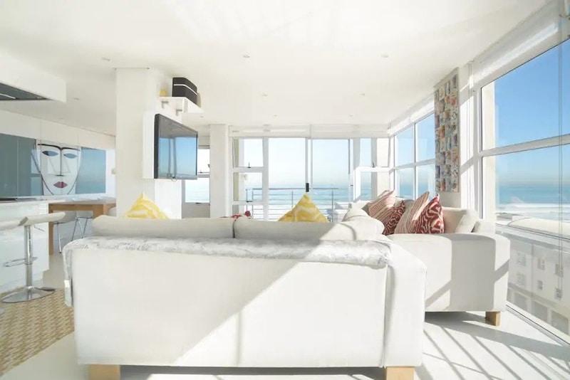 all-white-colour-scheme-lounge-airbnb-blouberg-cape-town