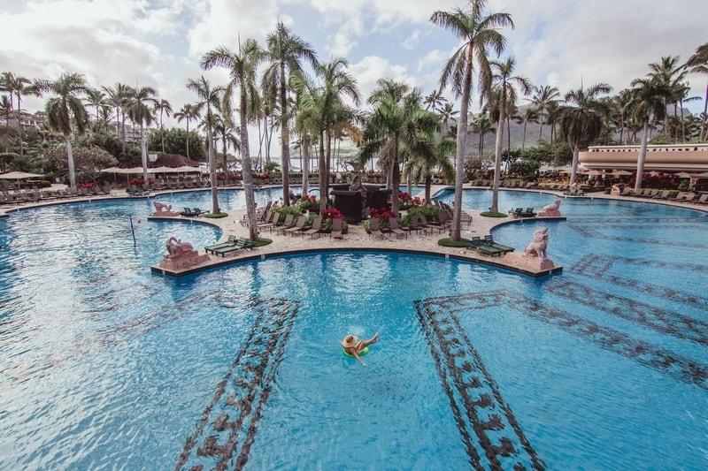 hawaiian resort pool with palm trees