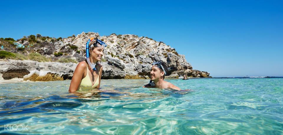 Two people on Rottnest Island with snorkel gear