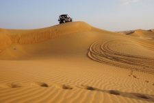 Vehicle on sand dune in the desert in Dubai