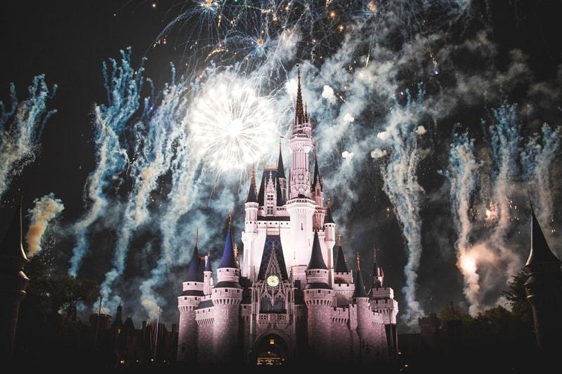 Fireworks behind the Walt Disney Castle at Disney World Orlando