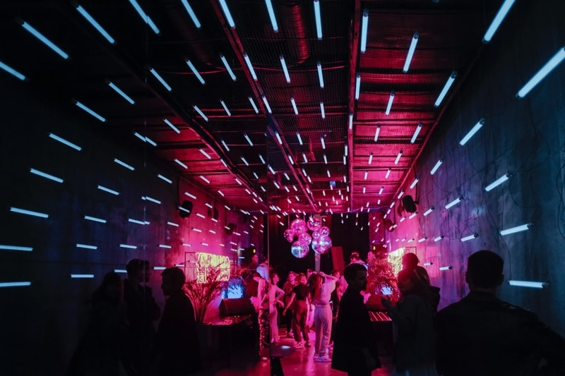 Pink and blue florescent lights in a corridor of a nightclub
