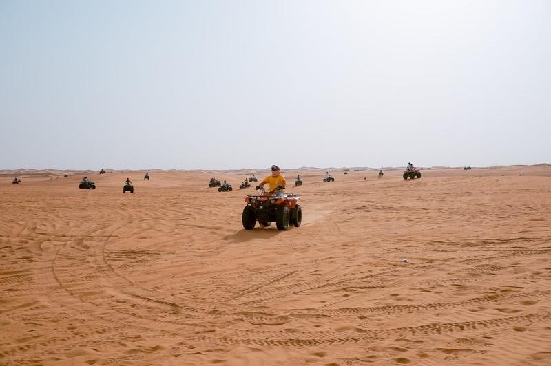 People on quad bikes in the desert