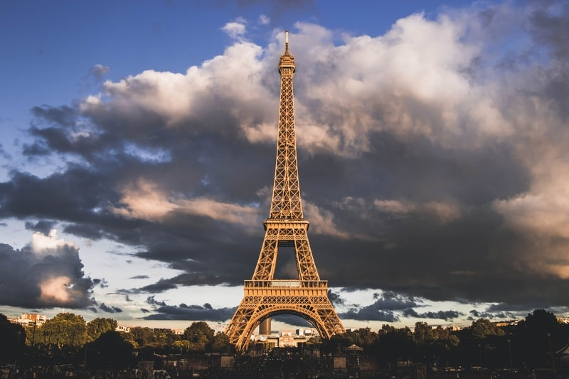 eiffel tower in paris cloudy sky in background