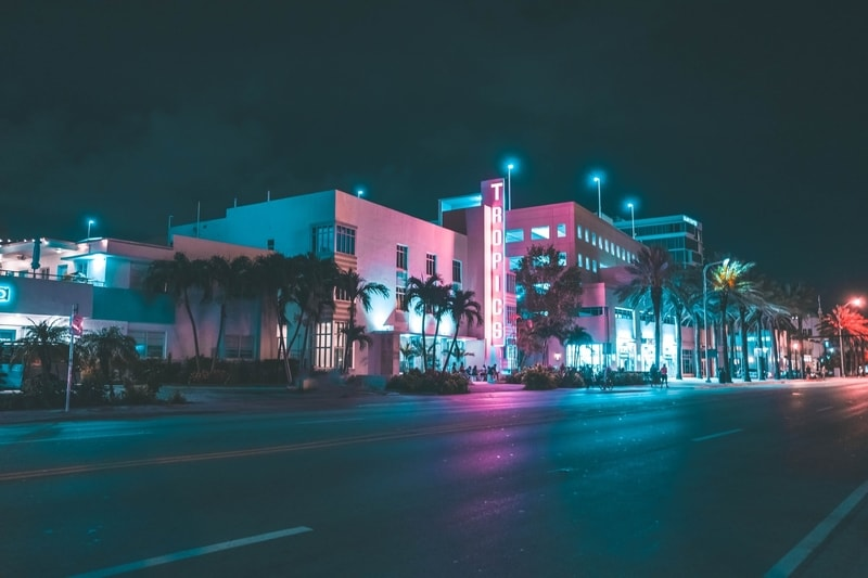 Purple and blue neon lights down the South Beach in Miami at night
