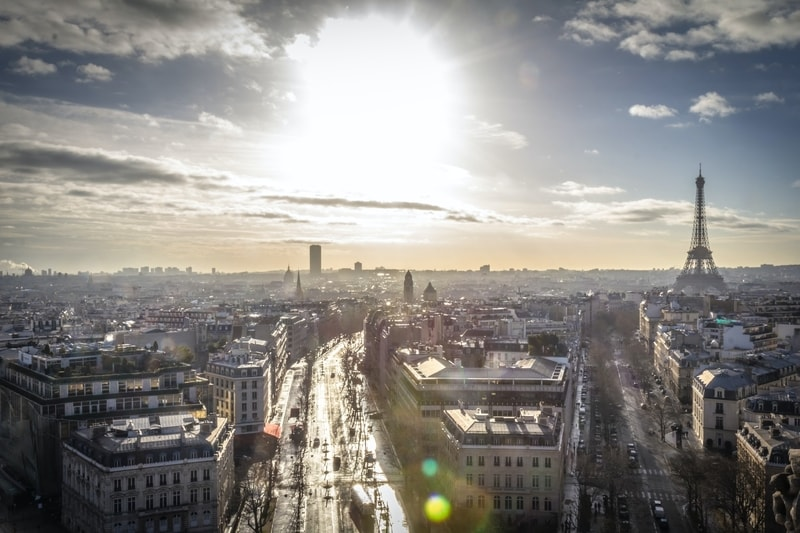 overview of city of paris with sun shining