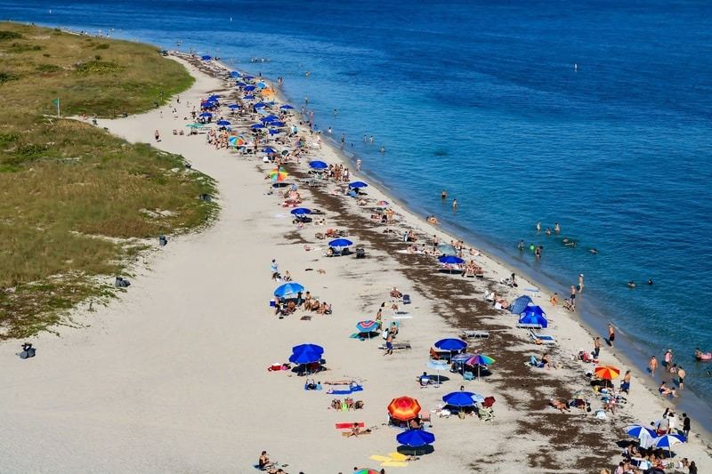 beach goers on the shores of west beach, Florida