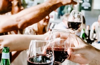 People toasting with wine glasses