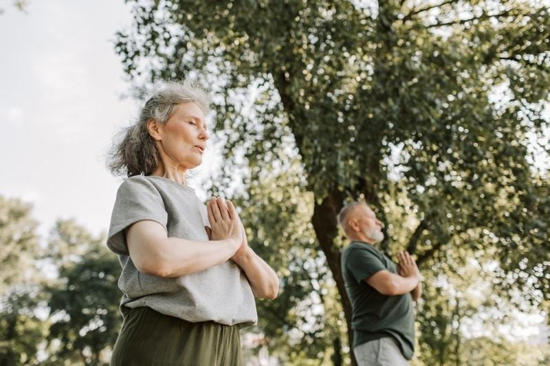 couple-doing-meditation-outside