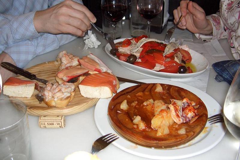 couple sharing Spanish dishes