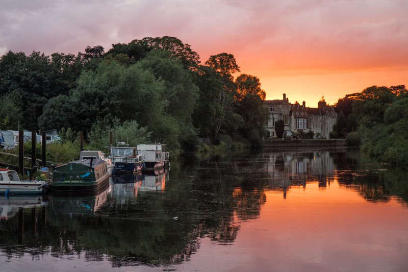 orange skies at sunset over the ouse river in york