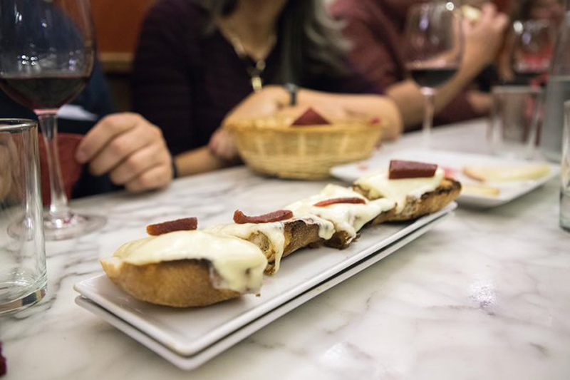 bread with cheese on a table during a tour